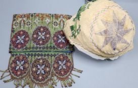 An early 20th century beadwork purse and an unmounted baby bonnet