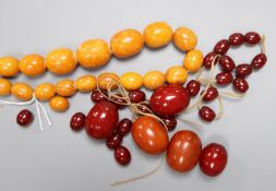 A single strand graduated amber bead necklace, 48cm, gross 40 grams, a large amber bead 10 grams and