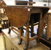 An early 18th century oak gateleg table, width 105cm, depth 38cm, height 70cm