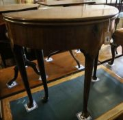 A George II mahogany and fruitwood games table, with hinged top and raised on pole and pad supports,