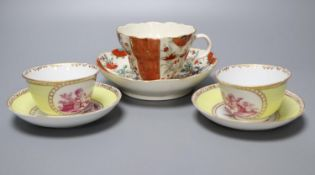 A Worcester cup and saucer, late 18th century, and a pair of Meissen outside printed coffee cups and