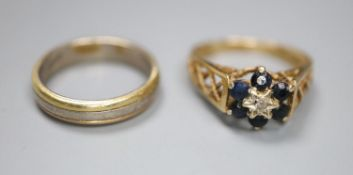 A Middle Eastern three colour metal ring and 9ct gold gem set ring, gross 2 grams.
