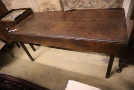 An 18th century provincial oak drop flap dining table, width 155cm, depth 66cm, height 71cm