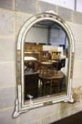 A simulated ivory wall mirror, width 80cm, height 105cm