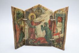 A small painted wood triptych, depicting the Raising of Lazarus in primitive style, height 25cm