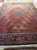 A Hamadan red ground carpet, 422 x 307cm