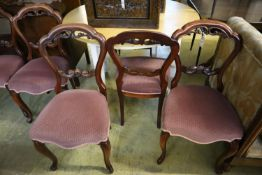 A set of six Victorian style mahogany balloon-back dining chairs, with stuffover seats on cabriole