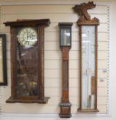 A Negretti and Zambra oak stick barometer, an admiral fitzroy barometer, a german wall clock -