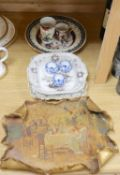 A gilt painted pottery plaque and mixed ceramics