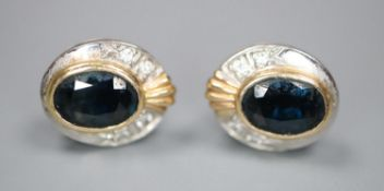 A pair of modern yellow and white metal, sapphire and diamond set oval cluster earrings, gross 3.5