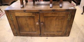 An 18th century oak two door cabinet, width 132cm, depth 44cm, height 71cm