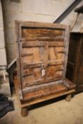 A low occasional table and an Eastern hardwood corner cupboard