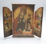 An 18th/19th century Greek/Macedonian painted and gilded wood triptych icon centred by an image of