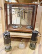 A mahogany cased set of Apothecary scales, two miner's lamps and a cut glass atomiser
