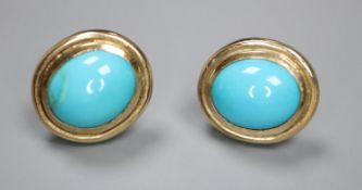 A pair of modern 9ct gold and cabochon turquoise set oval earrings ( one stone a.f., 12mm, gross 5.5