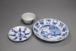 A Chinese Kangxi blue and white saucer dish and a similar tea bowl and saucer