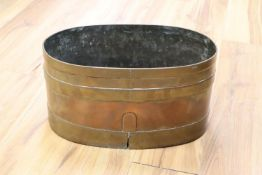 An early 19th century copper and brass bound log bin, length 43cm