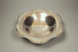 A circular silver tazza having shaped edge, engraved honeysuckle decoration and oval paterae Atkin