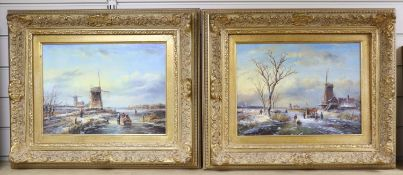 V* Beaumont (20th century Dutch School), Winter canal scene with figures skating and a windmill