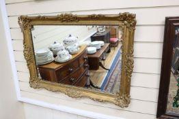 A rectangular gilt gesso wall mirror, width 85cm, height 62cm
