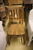 A set of four elm and beech provincial dining chairs
