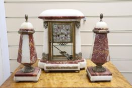 An Art Deco rouge and white marble clock garniture