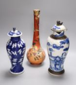 A Satsuma vase, 34cm, and two Chinese blue and white porcelain baluster jars and covers, all late