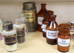 Eight Victorian and later glass chemists jars, each labelled, tallest 25cm