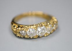A modern Victorian style 18ct gold and graduated old round cut diamond set half hoop ring, with