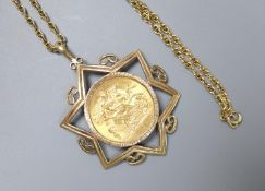 A 1932 gold sovereign, Pretoria Mint, in Star of David 9ct gold mount on yellow metal chain, gross