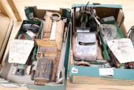 A collection of vintage tinplate/clockwork vehicles and stationery engines, including a Schuco