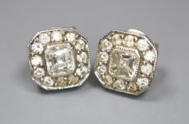A pair of 750 white metal and octagonal diamond cluster ear studs, with asscher? cut central stones,