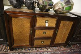 An Indian hardwood and rattan sideboard, width 140cm, depth 50cm, height 87cm