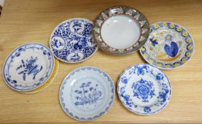 Seven various 18th century and later delft ware dishes, largest 24cm, some damage and a Studio