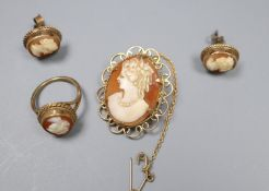 A modern 9ct gold and oval cameo shell set dress ring, a similar brooch and pair of ear studs, gross