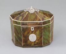 A George III silver mounted green stained tortoiseshell and ivory tea caddy, of decagonal form, with