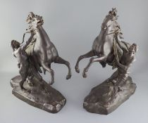 After Guillaume Coustou the Elder (French 1677-1746). A pair of bronze Chevaux de Marly, signed N.