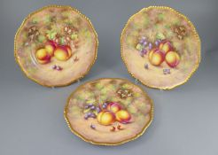 Three Royal Worcester fruit painted dinner plates, post-war, painted by Freeman, within gilt