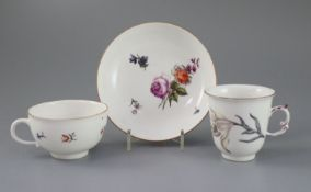 A Meissen botanical chocolate cup and a similar coffee cup and saucer, c.1740-50 each painted with