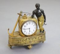 A 19th century French Empire bronze and ormolu mantel timepiece, modelled with a black sailor