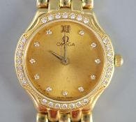 A lady's 18ct. gold Omega quartz wrist watch with diamond set bezel and numerals, on 18ct gold Omega