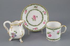 A Sevres cream jug, c.1768, and a Sevres hard paste coffee can and saucer, c.1781, the former