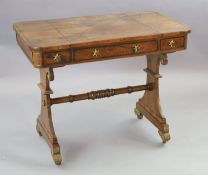 A Regency brass strung rosewood games table, with sliding reversible chess board top enclosing a