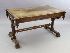 Attributed A.W.N. Pugin, A Victorian oak Gothic revival writing table, with saltire inlaid top,
