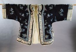 A Chinese black silk multi-coloured embroidered three quarter length winter jacket, late 19th