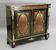 A 19th century French red buhl work and ebony side cabinet, with inverse breakfront and two panelled