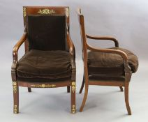 A pair of 19th century French Empire style ormolu mounted mahogany fauteuils, with cherub and lyre