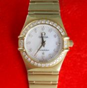 A lady's 1990's 18ct gold Omega Constellation quartz wrist watch with diamond set mother of pearl