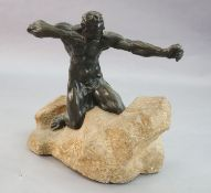 Alfredo Pina (1883-1966). A bronze figure of Héraclès kneeling upon a rocky mound, signed on the