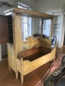A 19th Swedish grained pine extending box bed, combined cupboard, with moulded cornice and front